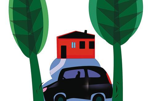 Samochód przy domu jednorodzinnym
